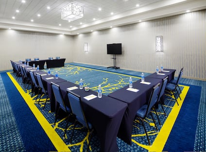 Meeting room with tables arranged in a U shape