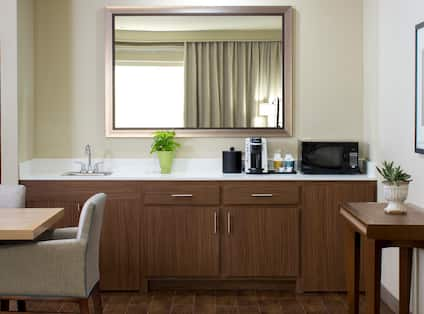 Kitchen in guest room living area with table and chairs and countertop
