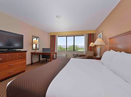 Guest Room with Luxurious King Bed, HDTV, and Work Desk