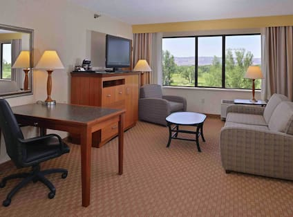 Junior Suite with Sofa, Work Desk, and HDTV