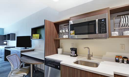 Kitchen with Stainless Steel Appliances and Stocked with Amenities