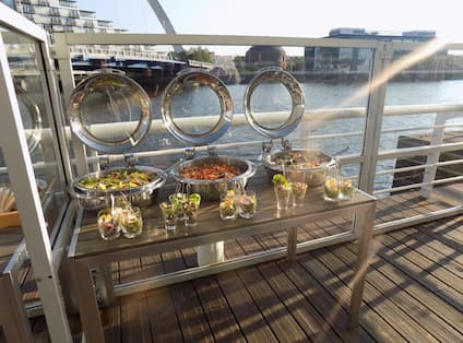 BBQ Buffet on Outdoor Deck with View of Water