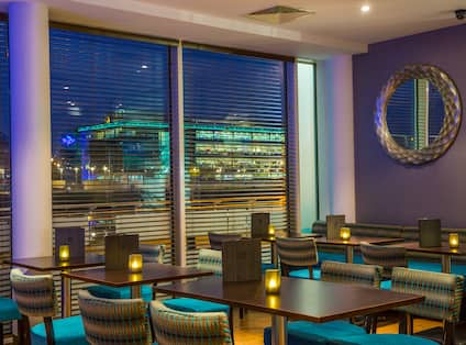 Bar at night with city view