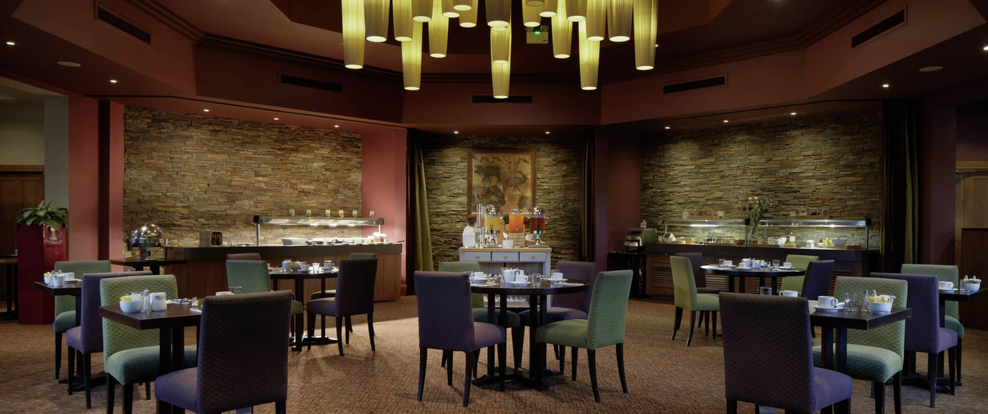 Breakfast Dining Area with Chairs, Tables and Food Buffet Counters