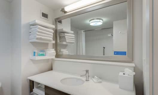 Bathroom with sink, mirror and towels