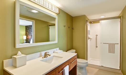 Guest Bathroom with Vanity, Mirror and Shower with Glass Sliding Doors