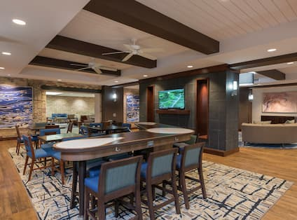 Ceiling Fans, Wall Art, TV, and Mixed Seating in Dining Area