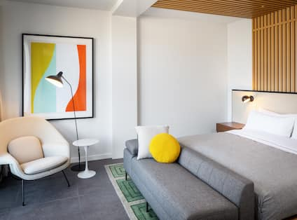Guest Room with Large Bed and Comfortable Seating Area