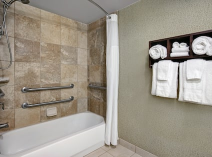 Bathroom with tub and towels