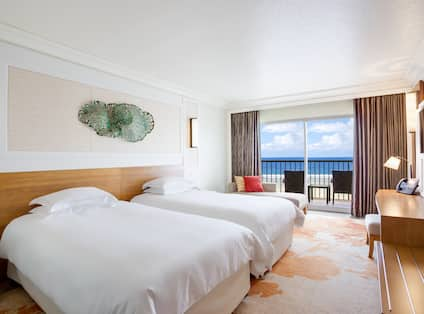 Twin Bed Guestroom With Balcony