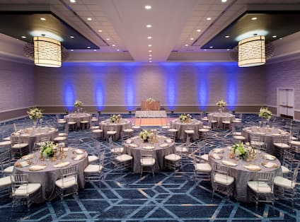 Ballroom with Linen Covered Tables and Floral Centerpieces