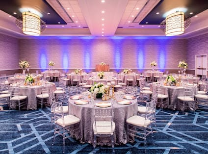 Ballroom with Linen Covered tables with Floral Centerpieces