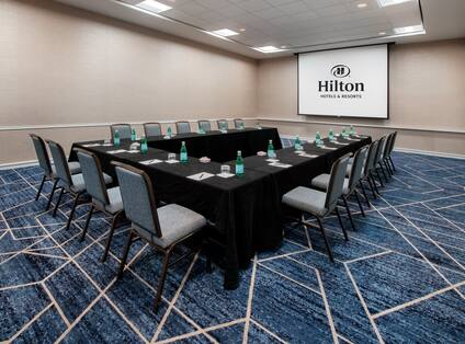 Hawthorn Meeting Room with U-Shaped Table and Media Screen