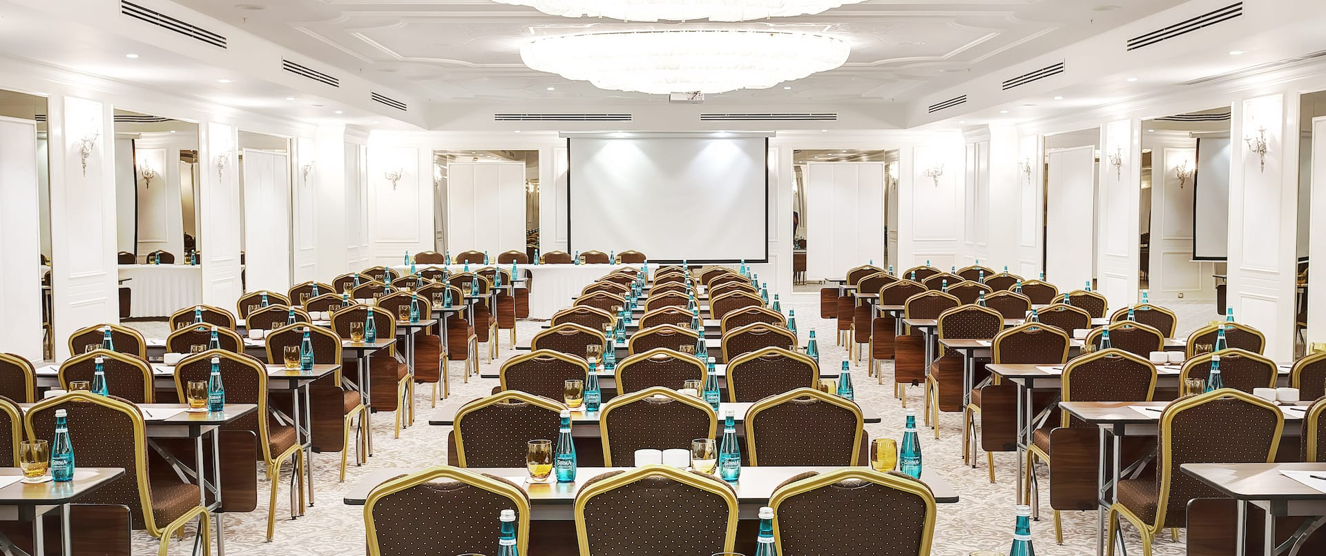 Meeting Room with Classroom Layout and Projector Screen