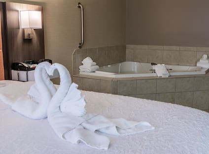 King bed with whirlpool and towels
