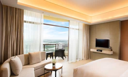 One King Bed Guest Bedroom with Sofa, Wall Mounted HDTV and Outside Balcony