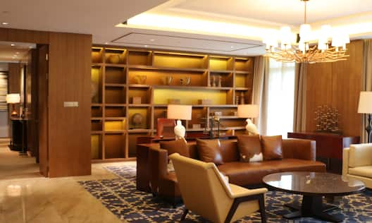 Guest Suite Lounge Area with Sofa, Armchair and Coffee Table