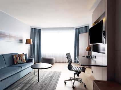 Suite Living Room with Couch, Work Desk and Television