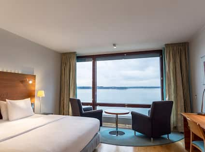King Bed and 2 Chairs with Sea View