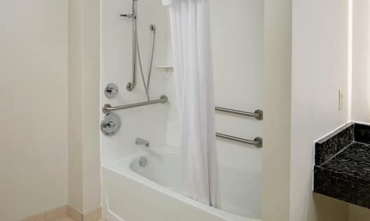 Accessible Guest Bathroom with Shower and Bathtub