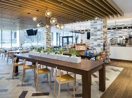 Herb N Kitchen seating at long table decorated with plants
