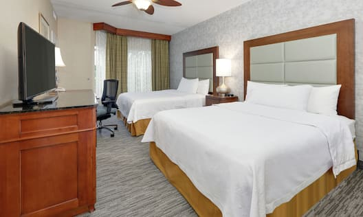 Accessible Guest Bedroom with Double Queen Beds and Television