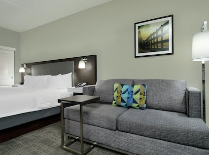 King Bed and Lounge Area in Whirlpool Suite