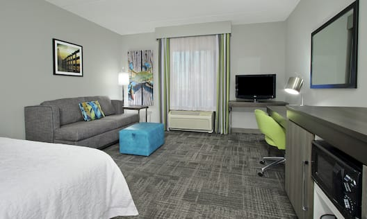 Guest Room with King Bed, Sofa Bed, TV, Work Desk, and Microwave