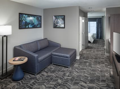 King Suite Living Area with Sofa, Television and Entrance to Bedroom