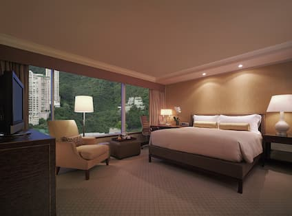 Guest Room with Luxurious King Bed, HDTV, and Outside View