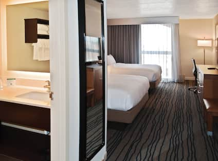 Two Queen Beds Guest Bedroom with Work Desk, HDTV and Bathroom