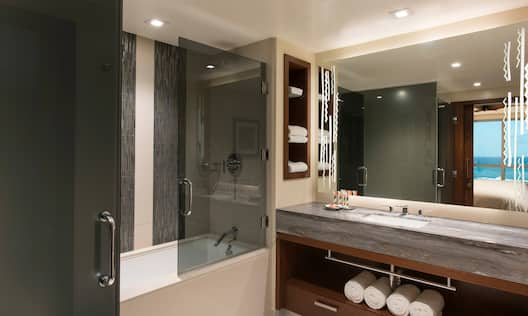 Ocean Luxury Guest Room Bathroom with Tub and Amenities