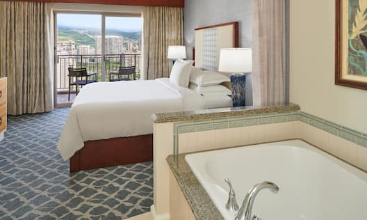 Bed in room with tub