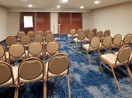 Meeting Room With Theater Seating For 32 Facing Presentation Easel and Podium