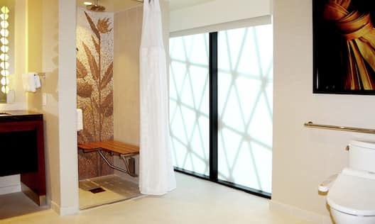 Accessible bathroom with roll-in shower and outside view