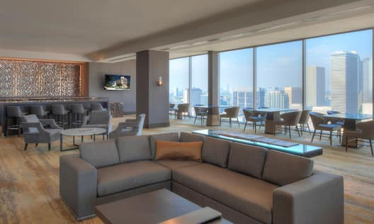 Rooftop Executive Lounge Area with Sofa, Chairs, Tables and City View