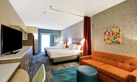 Studio Suite with Two Queen Beds, Lounge Area, Room Technology, and Work Desk