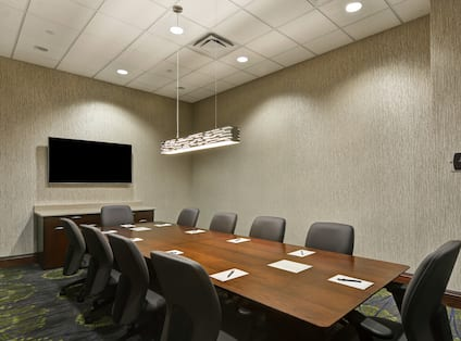 Seating for 10 atTable in Boardroom With TV