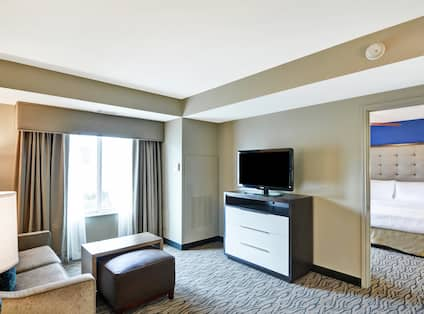 Suite Living Area With TV and 1 Bedroom