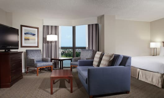 King Suite with Bed, Room Technology, Lounge Area, and Outside View