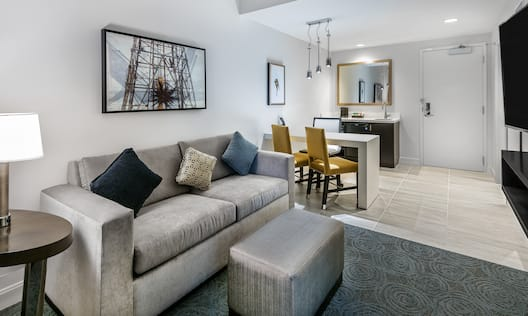 Suite Living Room with Sofa, Television, Work Desk and Wet Bar Kitchen