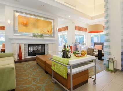 Additional Lobby Seating and Beverage Station by Fireplace