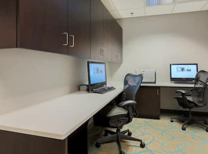Business Center with Two Computer Workstations, Rolling Chairs, and Printer