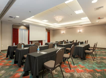 Nanuet Meeting Space in Classroom Style With Tables and Chairs Facing Presentation Screen