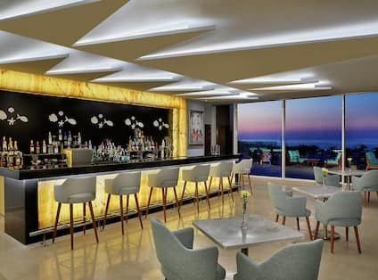 Hotel Onsite Bar with View of Sea at Dusk