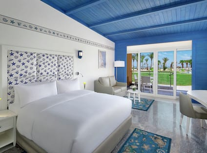 One King Bed with Bright Blue Wall and Ceiling with View of the Red Sea