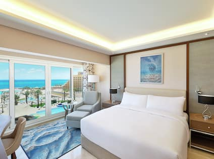 Suite with View of Sea and One King Bed with Desk and Workspace