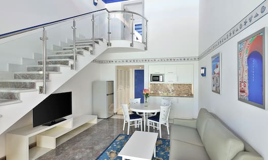 Living Area with Staircase to Second Level