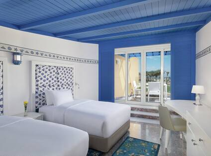 Bedroom with Two Twin Beds, Painted on White and Nautical Bright Blue and Outside Access to Private Terrace