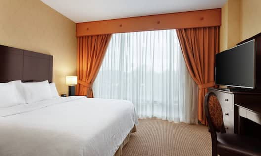 Accessible Guestroom King Suite with Bed, Room Technology, and Work Desk